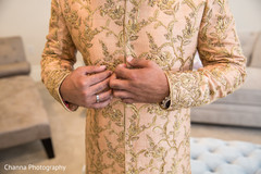 Indian groom getting ready with the sherwani