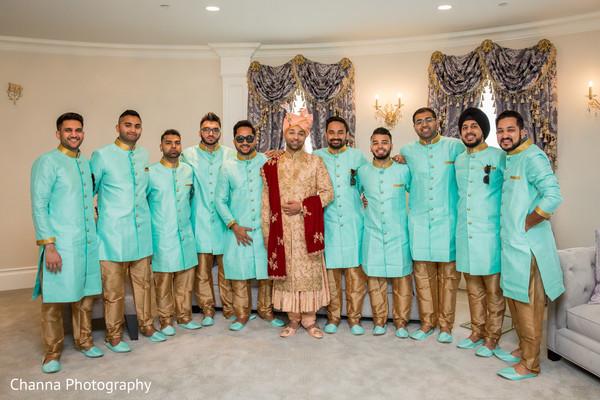 Groomsmen posing with Indian groom