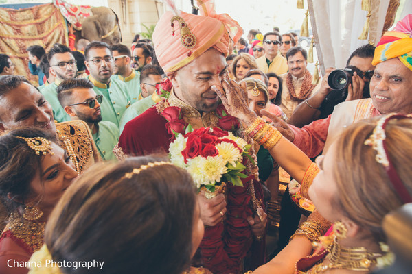 Indian groom being blessed by special guests