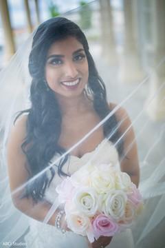 Indian bride on her white wedding dress.