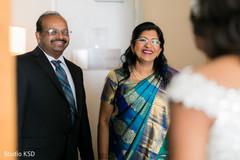 Marvelous capture of Indian bride meeting her parents.