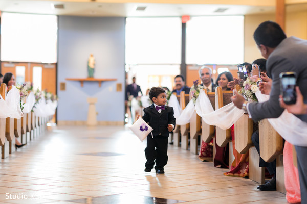 Lovely Indian pageboy walking down the aisle.