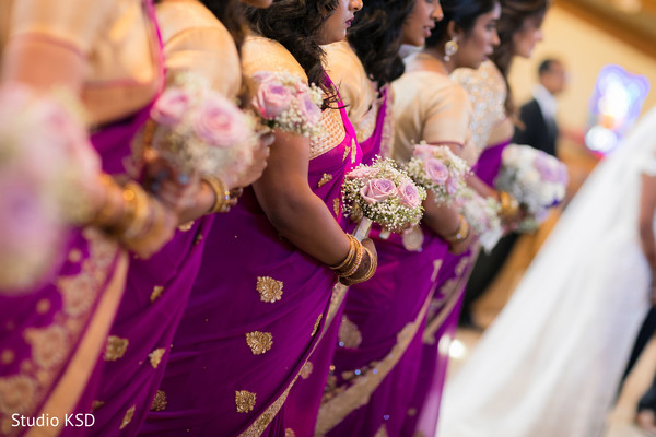 Indian bride with bridesmaids bouquets capture.