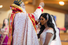 Enchanting Indian bride being blessed.