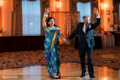 Ravishing Indian bridal parents making their entrance to reception.