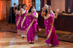 Upbeat Indian bridesmaids to wedding reception.