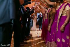 Ravishing Indian bride and groom entrance to wedding reception.