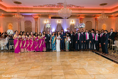 Indian couple with  wedding guests photography.