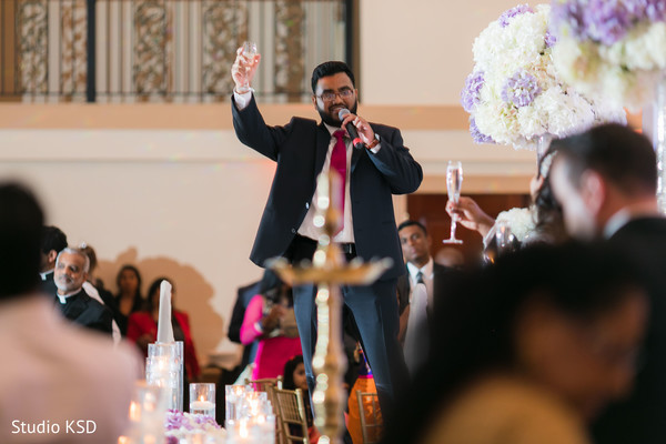 Indian groomsmen toast moment at reception.