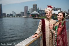 Indian bride and groom posing by the water