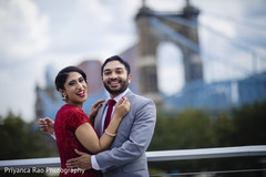 Indian groom and bride posing outdoors