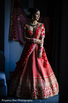 Indian bride posing with her glamorous lengha