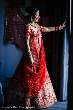 Detail of the Indian bride posing with lengha