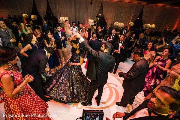 Indian groom and Maharani dancing