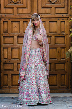 Indian bride posing with lengha