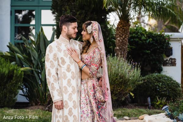 Enchanting couple wearing the wedding attires
