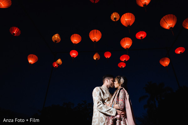 Indian couple kissing under the lights