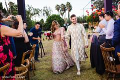 Joyful newlyweds leaving the ceremony venue