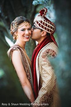 Indian groom kissing the beautiful Maharani