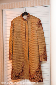 Colorful sherwani in the hanger