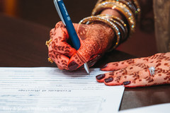 Indian bride signing marriage certificate