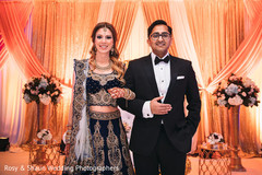 Indian wedding couple ricking their reception outfits