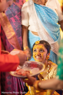 Maharani getting turmeric paste on.
