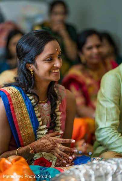 See this lovely Indian bride at her mehndi party.