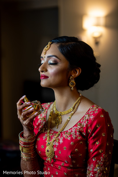 Maharani putting her perfume on.