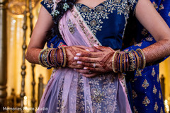 Closeup capture of Indian bridal mehndi and choora.