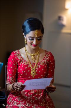 Indian bridal capture reading a letter.