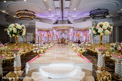 Dreamy Indian wedding ceremony aisle flower decoration.