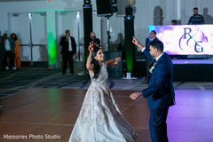 Great dance of Indian couple at reception party.