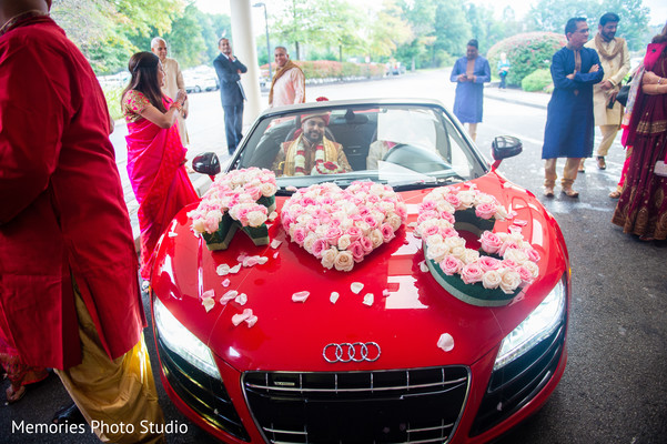 Elegant Indian lovebirds wedding vehicle.