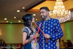 Indian couple with their dandiya sticks photo.