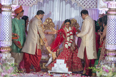 Maharani walking with raja around the sacred fire.