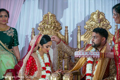 Indian couple at their Sindoor wedding ritual.