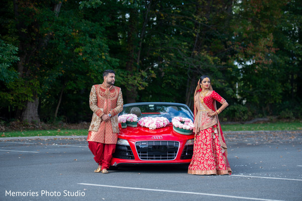 Elegant Indian bride and groom posing for photo shoot.