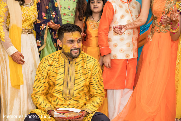 Charming groom at haldi party capture.