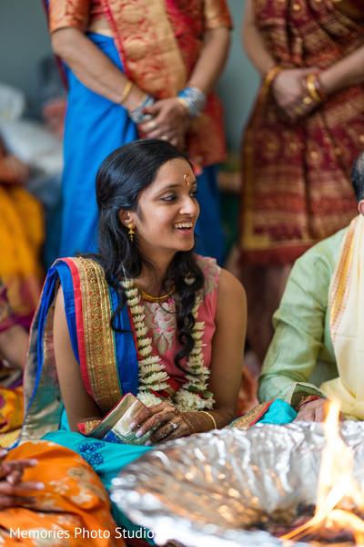 Joyful Indian bride at her pre-wedding party.