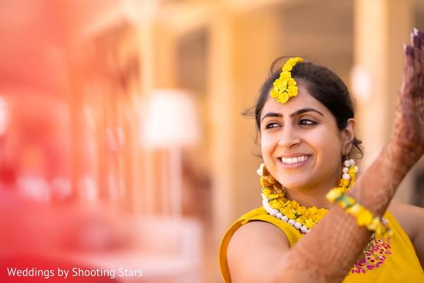 Joyful Indian bride at the Mehndi celebration.