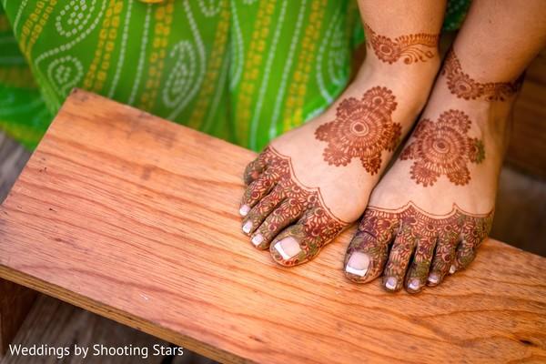 Elegant Indian bridal feet henna art.