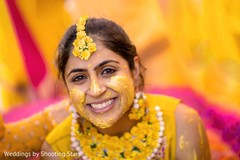 Enchanting Indian bride portrait with turmeric paste on.