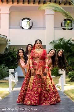 Adorable Indian bride posing with bridesmaids.