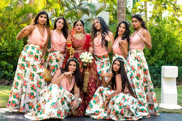 Indian bride and bridesmaids outdoors capture.