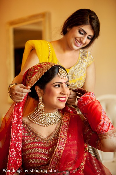 Indian bride getting ready for ceremony capture.