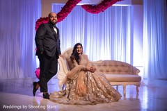 Gorgeous Indian bride and groom posing for photo shoot.