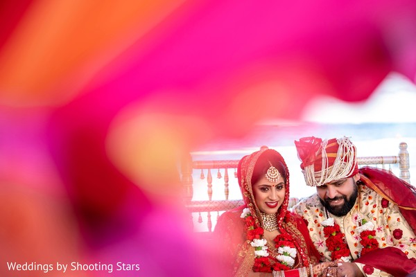 Dreamy capture of Indian bride and groom at wedding ceremony.
