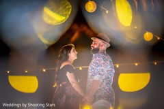 Adorable Indian bride and groom face to face outdoor portrait.