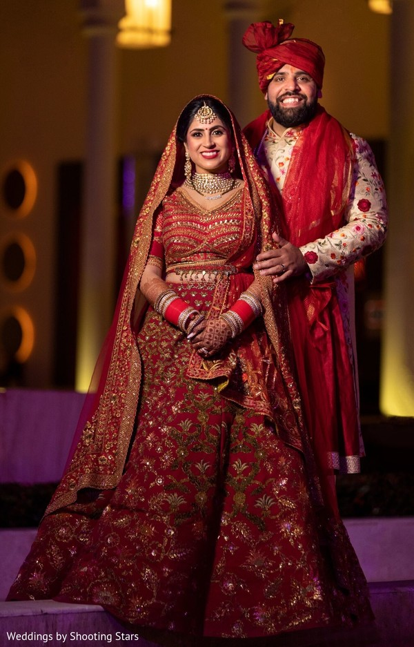 Stunning portrait of Indian bride and groom .